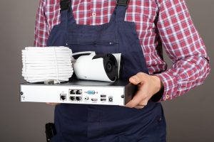 Close up picture of CCTV Engineer hands holding surveillance camera kit